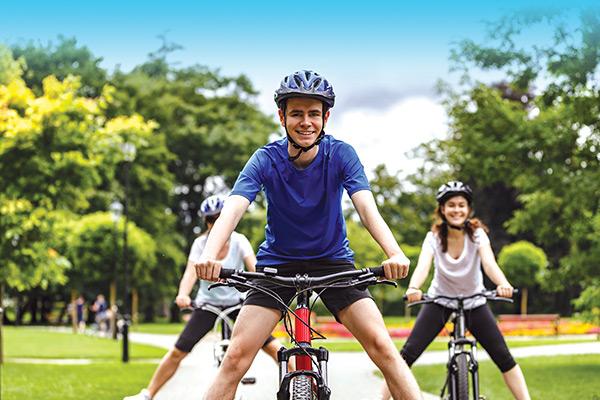 Teens riding bikes outside